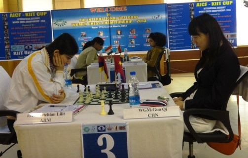 Guo Qui (right) was steady against Lilit until the mistake cost her dearly
