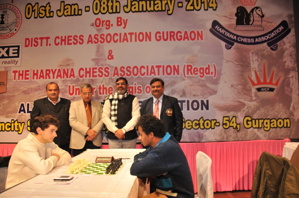 Shri. G L Sharma along with Shri. Naresh Sharma, Shri.Rajpal Chauhan and Chief Arbiter Dharmendra Kumar is watching the first board proceedings of Karvtsiv Martyn and Kunal M in the fourth round
