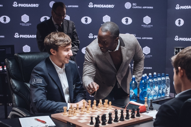 Carlsen Holds Karjakin In Game Nine