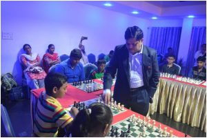 Mr.Lanka Ravi International Master &Sr FIDE Trainer playing with local talents.